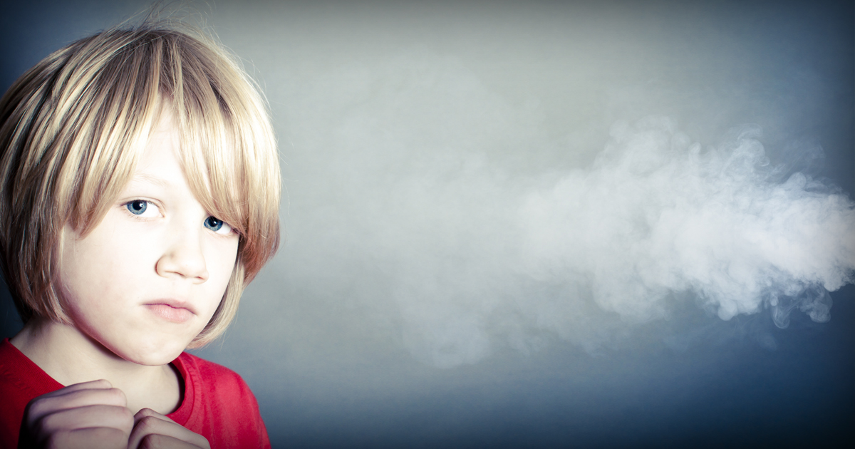 child breathing secondhand smoke