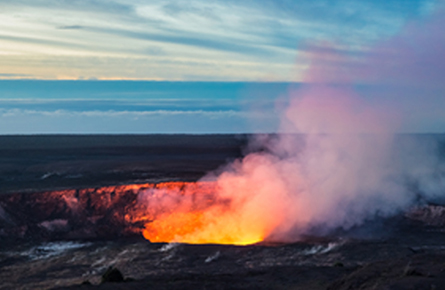 Volcano crater with smoke and lava
